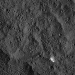 This image, taken by NASA's Dawn spacecraft, shows a small patch of bright material close to the northern rim of the giant crater Yalode, seen at lower left. Yalode is one of the largest impact basins on Ceres.