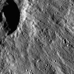 This image from NASA's Dawn spacecraft shows a scene located at mid-latitudes in the southern hemisphere of Ceres. The view features a portion of a crater between the large impact features Urvara and Yalode.