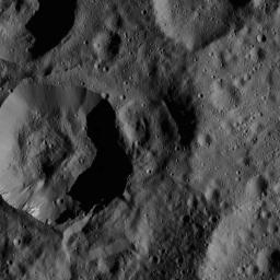 This image, taken by NASA's Dawn spacecraft, shows unnamed craters high in the northern hemisphere of Ceres. A bright patch of material can be seen on the upper wall of the large crater (near the lower left corner of the view).