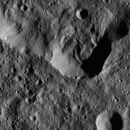 This image, taken by NASA's Dawn spacecraft, shows a portion of the southern rim of Jarovit Crater in the northern hemisphere of Ceres. Compacted material forms spurs along the upper part of the crater wall, near the center of the image.
