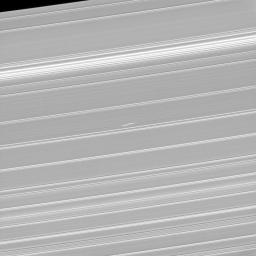 What appears as a pair of bright dashes at the center of this image is one of the features rings scientists have dubbed 'propellers.' This image of Bleriot is from NASA's Cassini spacecraft.