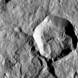 In this image of Ceres from NASA's Dawn spacecraft, a younger, fresher crater lies to next to the older, larger crater named Messor. Messor, which is named for the Roman god of the harvesting and cutting of grain.