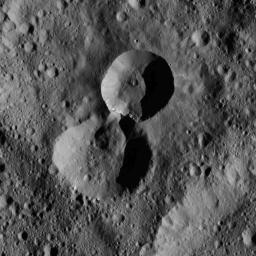 This pair of craters is located in the northern hemisphere of Ceres as seen by NASA's Dawn spacecraft. The wall of the older crater (lower of the two) has partially collapsed where it adjoins the rim of its younger neighbor.