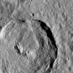 Tupo Crater, named for a Polynesian god of turmeric, is featured in this view of Ceres from NASA's Dawn spacecraft. This impact feature is 22 miles (36 kilometers) in diameter and features a prominent central ridge of mountain.