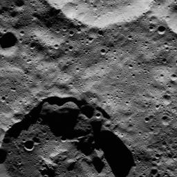 This view from NASA's Dawn spacecraft shows two medium-sized craters at high northern latitudes on Ceres.