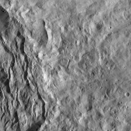 This image from NASA's Dawn spacecraft shows the rim of Occator crater, just east of the area containing the brightest spots on Ceres. The crater rim has collapsed, leaving structures geologists refer to as terraces.
