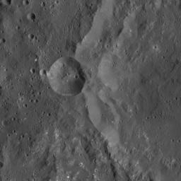 This image from NASA's Dawn spacecraft shows the western rim of Azacca Crater on Ceres. A smaller impact feature sits on its flank. Of particular interest in this scene is the great number of small, bright spots, in the southern part of the image.