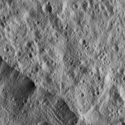 This picture from NASA's Dawn spacecraft shows a portion of the northeastern rim of Yalode Crater, one of the largest impact features on Ceres. A set of narrow, roughly parallel fractures can be seen at top center.