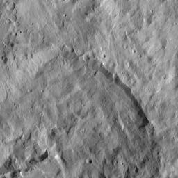 This picture captured by NASA's Dawn spacecraft shows a crater that lies just north of Occator Crater, home of the brightest spots on Ceres. The northern rim of Occator, not visible here, is overprinted on the southern rim this crater.