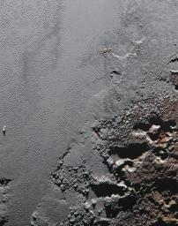 This enhanced color view from NASA's New Horizons spacecraft zooms in on the southeastern portion of Pluto's great ice plains, where at lower right the plains border rugged, dark highlands informally named Krun Macula.