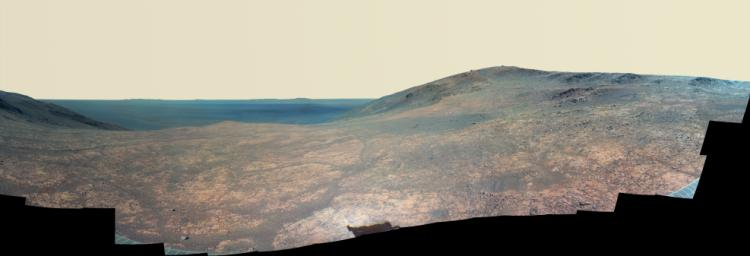 'Marathon Valley' on Mars opens northeastward to a view across the floor of Endeavour Crater in this enhanced color scene from the panoramic camera (Pancam) of NASA's Mars Exploration Rover Opportunity.
