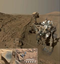 This scene shows NASA's Curiosity Mars rover at a location called 'Windjana,' where the rover found rocks containing manganese-oxide minerals.