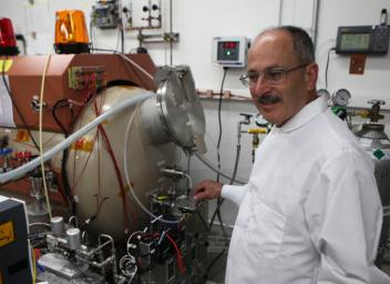 One investigation on NASA's Mars 2020 rover will extract oxygen from the Martian atmosphere. It is called MOXIE, for Mars Oxygen In-Situ Resource Utilization Experiment. Shown here is Michael Hecht, of MIT in the development lab at JPL.