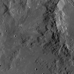 Smooth terrain around the western rim of Ikapati Crater on Ceres is visible in this image from NASA's Dawn spacecraft. The area contains material ejected from Ikapati during its formation.