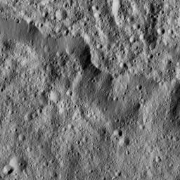 A portion of the rim of giant Yalode Crater is seen in this image of Ceres. Yalode is approximately 162 miles (260 kilometers) in diameter. NASA's Dawn spacecraft took this image on June 15, 2016.