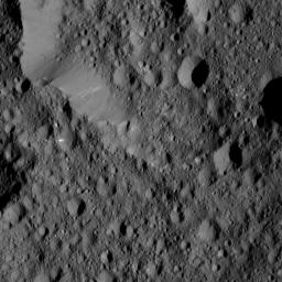 NASA's Dawn spacecraft took this view from Ceres on June 16, 2016, showing Ernutet Crater (32 miles, 52 kilometers in diameter) at top.