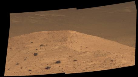 This scene from the panoramic camera (Pancam) on NASA's Mars Exploration Rover Opportunity shows 'Spirit Mound' overlooking the floor of Endeavour Crater.