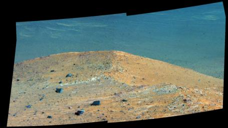 This enhanced scene from the panoramic camera (Pancam) on NASA's Mars Exploration Rover Opportunity shows 'Spirit Mound' overlooking the floor of Endeavour Crater.