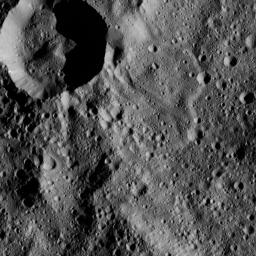 This view from NASA's Dawn spacecraft shows terrain in the southern hemisphere of Ceres. Most of the image is the impact crater named Annona (37 miles, 60 kilometers across); the smaller, prominent crater at upper left is unnamed.