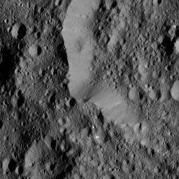 This view, taken on June 17, 2016 from NASA's Dawn spacecraft, shows the rim of Ernutet Crater (32 miles, 52 kilometers in diameter) on Ceres.