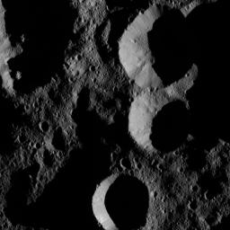 NASA's Dawn spacecraft obtained this view of shadowed craters near Ceres' north pole at a distance of about 240 miles (385 kilometers) above the surface on May 28, 2016.