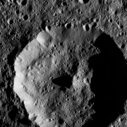 The cone-shaped central peak of a Cerean crater casts a long shadow in this view from NASA's Dawn spacecraft taken on May 28, 2016 from its low-altitude mapping orbit above Ceres at a distance of about 240 miles (385 kilometers) above the surface.