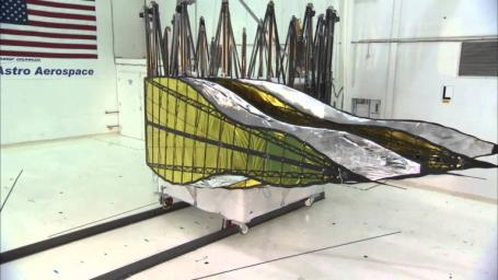 A furled first prototype starshade developed by NASA's Jet Propulsion Laboratory, shown in technology partner Astro Aerospace/Northrup Grumman's facility in Santa Barbara, California, in 2013.