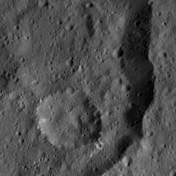 This view from NASA's Dawn spacecraft, taken on May 29, 206, shows part of the floor and eastern rim on Consus Crater (40 miles or 64 kilometers wide) on Ceres.