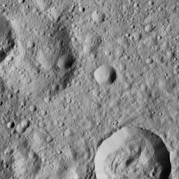 This view from NASA's Dawn spacecraft shows cratered terrain on Ceres, centered at 10 degrees south latitude, 197 degrees east longitude.
