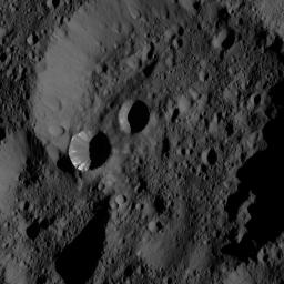 NASA's Dawn took this image on June 3, 2016, from its low-altitude mapping orbit, at a distance of about 240 miles (385 kilometers) above the surface. This view shows terrain located at approximately 60 degrees north latitude on Ceres.