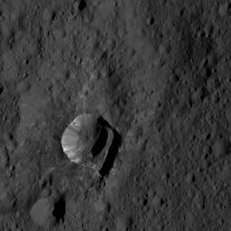 NASA's Dawn spacecraft views Oxo Crater (6 miles, 10 kilometers wide) in this view from Ceres, taken on June 4, 2016, from its low-altitude mapping orbit, at a distance of about 240 miles (385 kilometers) above the surface.