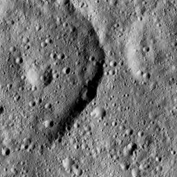 NASA's Dawn took this image on June 17, 2016, of Tibong Crater (22 miles, 36 kilometers wide), at left, on Ceres.