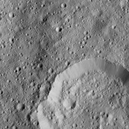 This image from NASA's Dawn spacecraft, tkane on June 6, 2016, shows Piuku Crater (19 miles, 31 kilometers wide), bottom, on Ceres.