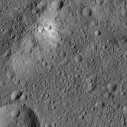 This image from NASA's Dawn spacecraft, taken on June 6, 2016, features bright material (at upper left) along the rim of the giant crater named Kerwan (174 miles, 280 kilometers wide) on Ceres.