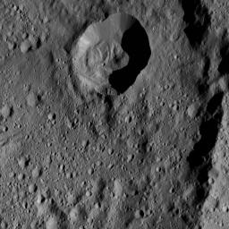 This image from NASA's Dawn spacecraft, taken June 8, 2016, shows an area within Ezinu Crater on Ceres. Ezinu, which is 72 miles wide, was named for the Sumerian goddess of grain. Part of the crater's eastern rim is visible along the right side.