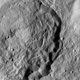 This image from NASA's Dawn spacecraft shows Kondos Crater on Ceres. Dawn took this image on June 10, 2016, from its low-altitude mapping orbit, at a distance of about 240 miles (385 kilometers) above the surface.
