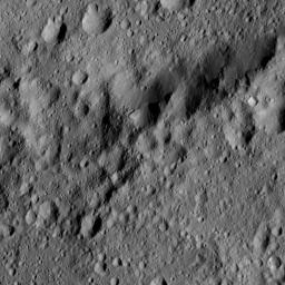 This image from NASA's Dawn spacecraft shows the edge of Ezinu Crater on Ceres. Dawn took this image on June 10, 2016, from its low-altitude mapping orbit, at a distance of about 240 miles (385 kilometers) above the surface.
