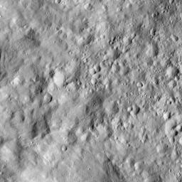 This image from NASA's Dawn spacecraft, taken on June 12, 2016, shows terrain on Ceres covered by ejecta from a nearby impact, which has smoothed the appearance of older features.
