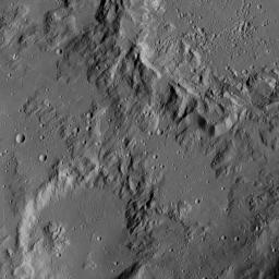This image from NASA's Dawn spacecraft shows the edge of Ikapati crater on Ceres, at upper right. Dawn took this image on June 12, 2016, from its low-altitude mapping orbit, at a distance of about 240 miles (385 kilometers) above the surface.