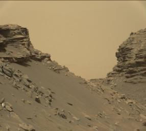 This view from the Mast Camera (Mastcam) in NASA's Curiosity Mars rover shows sloping buttes and layered outcrops within the 'Murray Buttes' region on lower Mount Sharp.