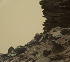 This view from the Mast Camera (Mastcam) in NASA's Curiosity Mars rover shows a hillside outcrop with layered rocks within the 'Murray Buttes' region on lower Mount Sharp.