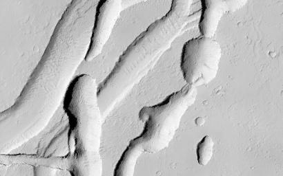 This image from NASA's Mars Reconnaissance Orbiter shows a complicated area containing various types of channels, pits and fractures near Olympica Fossae.