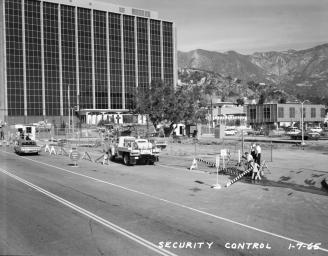The Administration Building of NASA's Jet Propulsion Laboratory (Building 180) is pictured in this archival image taken in January 1965. What appears as a parking lot in this photograph later becomes 'The Mall,' a landscaped open-air gathering place.