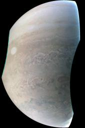 This image, taken by NASA's Juno spacecraft's JunoCam imager, highlights the seventh of Jupiter's eight 'string of pearls,' massive counterclockwise rotating storms that appear as white ovals in the gas giants southern hemisphere.