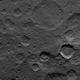 Relatively young craters, with sharp crater rims and streaks of bright material, are the focus of this view of Ceres from NASA's Dawn spacecraft, taken on Oct. 17, 2016.