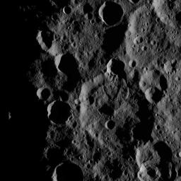 This view from NASA's Dawn spacecraft features a lobe-shaped flow feature in Ghanan Crater on Ceres. The flow feature is a place where a crater rim has collapse and material has flowed across the surface.