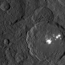 This image, taken on Oct. 18, 2016 from NASA's Dawn spacecraft shows Occator Crater on Ceres, with its signature bright areas. The central bright spot, which harbors the brightest material on Ceres, is believed by scientists to contain a variety of salts.