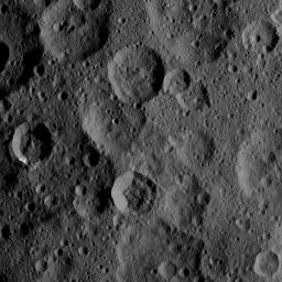 The craters Takel and Cozobi are featured in this image of Ceres from NASA's Dawn spacecraft. Takel is the young crater with bright material on the left of this image, and Cozobi is the sharply defined crater just below center.