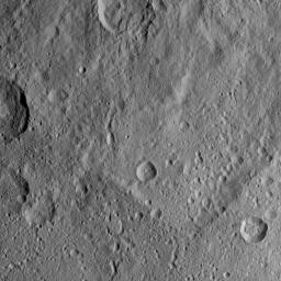 This scene viewed by NASA's Dawn spacecraft on Oct. 20, 2016, from Ceres features terrain near the rim of the large crater named Kerwan, at lower left. A much smaller, fresher crater called Cacaguat is seen in the lower right corner.