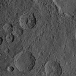 This scene captured by NASA's Dawn spacecraft on Oct. 21, 2016, from Ceres' northern hemisphere shows part of the rim of Dantu Crater, at top right. Rao Crater is the largest crater in the bottom left corner of the image.